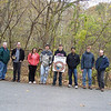 10.28.11 Tree Maintenance &amp; Cleanup in Patapsco State Park : The Friends of Patapsco Valley &amp; Heritage Greenway sponsored a fall tree planting on Friday, October 28st! What a beautiful afternoon in the Orange Grove Area of Patapsco State Park, on the Grist Mill Trail which runs paralllel to the Patapsco River, close to Relay. With the help and assistance of the wonderful Patapsco State Park rangers, they helped us recycle some of the wood stakes and wire mesh cages to use for other trees in the park and brought a park truck to help us remove some trash we picked up along the way too!  Thirteen wonderful volunteers helped us pull out weeds growing up the trees, trim tree limbs and readjust wooden stakes so trees that were previously planted will continue to grow along a riparian buffer off of a section of the Patapsco River that runs along the Grist Mill Trail! Special thanks to our Tree Captains Betsy McMillion, Tim Titus and Ranger Jamie Petrucci as well as all our other wonderful helpers that joined us to help nurture these trees providing an important buffer to this stream and picking up all that other trash that was washed down the river in this area from the September 7th Tropical Storm Lee!   We spotted a large flock of black birds hanging around by our site, a beautiful blue heron and unfortunately, we saw a lot of plastic bags that were washed down the river and ended up on the trees after the water level went down.  Some of the more interesting trash we removed that day include:  A stack of Pokemon cards in a plastic zip lock bag, mini toy vehicles, pair of sunglasses, plastic toy policeman, toy detective badge, a steel locker from the railroad, 2 tires, basketballs, two decorative edging bricks, a Baltimore County Fire Department canoe paddle and lots of plastic bag pieces, as well as plastic and glass bottles!