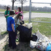 3.17.12 Cleanup Along Northfield Elementary Stream in Ellicott City : The Friends of Patapsco Valley &amp; Heritage Greenway partnered with the Northfield Elementary PTA for a cleanup along the stream that runs through Northfield Elementary School! Special thanks to the 85 volunteers who showed up throughout this event to help remove 15 bags of trash from this watershed area! Aside from the usual bottles, cans, plastic bags and food wrappers we usually find in our cleanups (washed down storm drains from litter in the streets and parking lots), volunteers also removed a lot of balls (lacrosse, basketball and other sports), a Chinese box, beach pail, big plastic sheet, styrofoam, half a frisbee, corrugated pipe metal, bike helmet, doll, hat, broken swing, canteen, big truck mud flap, and a big orange plastic USPS pallet!  A special thanks to our Stream Captains Tim Titus, Susan Hobby and Jeff Klein who led the group, and all the wonderful teachers, parents, students, scouts and other family members who came out to help!  Thanks to all of our volunteers for a job well done!