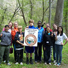 4.12.12 Patapsco River Orange Grove Cleanup With Hammond Middle School : The Patapsco Heritage Greenway sponsored a cleanup along the Patapsco River in the Orange Grove Area of Patapsco State Park.  PHG partnered with Hammond Middle School as part of the 7th grade student service learning project to remove trash and invasive garlic mustard from the Patapsco River watershed.  A total of 111 volunteers removed 1,787 pounds of trash and 244 pounds of invasive garlic mustard in just two hours!  Some of the interesting trash removed include:  pieces of lumber, a wooden pallet, various metal railroad parts, a horse feedbag, some sandbags, aluminum siding, two pairs of old children's shoes, styrofoam cups, plastic grocery bags, wire, a very long pipe and a very large pair of mens undershorts, large truck tire with a metal rim, small truck tire and 2 regular truck tires.   Congratulations to Team 13 who were the winners of all the student groups who removed an amazing 451 pounds of trash and 147 different items of trash!  Congratulations to Team 10 who was the winner of all the student groups who removed an amazing 68 pounds of invasive garlic mustard!   Special thanks to Teacher Jennifer Furman, who organized this year's service learning cleanup project and the PHG Stream Captain Team who helped run the event including:  Betsy McMillion, Jeff Klein, Pete McCallum, Kathy Younkin, Kathy Swan, Dave Hutton, Chris Fiorito and HCC Student helpers Yessica Calderon, Victor Ramier and Rashard Hill!  And a special thanks to our park rangers who removed the trash for us!!!    Thanks to everyone who made today's cleanup a big success!