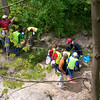 4.14.12 New Cut Road Stream Cleanup : The Patapsco Heritage Greenway sponsored a stream cleanup along New Cut Road, in the Worthington Park area. Special thanks to our wonderful partners from the Boy Scouts (Pack 495, Troop 615), the Howard County Rotaracts and Mt. Hebron NHS who all brought several energetic volunteers! With the remarkable efforts of these groups, as well as some of our PHG friends, we removed an amazing 2300 pounds of trash and litter from this watershed area!! Aside from the usual bottles, cans, plastic bags and food wrappers we usually find in our cleanups (washed down storm drains from litter in the streets and parking lots), volunteers also removed 14 tires! Some of the interesting items found: mostly rusted scrap metal &amp; pipes, construction debris such as wire and cables, BGE supplies, lids to plastic tubs, traffic cones, a large indoor/outdoor carpet stuck in a tree and rock (probably from the flood), an old water heater, a bike frame, a lawn chair, a sled, an arrow from a crossbow, an unused shotgun shell, various parts of car bumpers &amp; a 1953 Plymouth Belvedere hubcap in excellent condition. Great work and special thanks to the Stream Captains Carol &amp; Brian Curley, and to all of our volunteers for a job well done!!