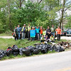 4.21.12 Stream Cleanup Along Coopers Run & Historic #9 Trolley Trail in Oella : The Patapsco Heritage Greenway partnered with G.O.C.A, Salem Lutheran Church and the Southwest Baltimore County Democratic Club to clean Coopers Run--along the #9 Trolley Trail. Leading this group of 62 volunteers was our stream captains Jeff Klein & Julia Graham, along with the help of Jay Patel; the G.O.C.A. President. What they removed from this stream was the usual stream trash including plastic bottles, food wrappers, cans and glass liquor bottles. Some of the more interesting items found included: about 500# scrap metal, about 30# of lumber, 2 tires, carpeting, blankets, 25' lead pipe, a moped, tent stakes in a bag and an engine block in the stream--which will need a winch to remove. They also noticed heavy erosion with some outflow pipes being exposed. Nature spotting included: a turtle, deer and ducks in the stream. Many thanks to all those who helped do such a great job cleaning up this portion of the Patapsco Watershed!