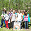 "4.24.13 Cleanup along the Patapsco river with Glenwood Middle School : Patapsco Heritage Greenway sponsored a river cleanup and an invasive plant removal event with 118 participants on a warm Wednesday in April, in the Orange Grove Area of Patapsco State Park in Howard County, Between the parking lot up to Bloede Dam. We send a special thanks to Glenwood Middle School who sent their 7th grade class along with teachers, staff and parent helpers, as well as some of our PHG friends to help remove an amazing 1,907 pounds of trash/invasive garlic mustard from this watershed area. The breakdown was 2,601 pounds of trash and 82 pounds of garlic mustard! Quite a bit of the larger trash was a result of debris washed down the river from Tropical Storm Sandy and other major storms in the past 2 years. PHG has been targeting areas throughout the park for the past 13 years removing the invasive garlic mustard plant, teaching others about this ""villain of the valley"" and problems in general with invasive plants. PHG has been working with Patapsco State Park Rangers to clean up this area, and what a difference these volunteers made in just a few hours! Aside from the usual bottles, cans, plastic bags and food wrappers we usually find in our cleanups (washed down storm drains from litter in the streets and parking lots), volunteers also removed:   Volunteers also noticed a lot of interesting bits of nature including a really old bottl, 10 tires, rubber tubing, tire rim, rope, pieces of carpet, dirty diapers, rusted steel drum, railroad ties, lots of scrap metal pieces, bottom of an office swivel chair, swimming mask, lots of pieces of plastic bags, car bumper, propane tank, steel beam, boots, plastic tarp, bricks, vinyl siding, pair of pants, chicken wire fencing, plastic contractor's bucket, metal can, rusted frame of old tricycle, bottom of a scooter, piece of electric stove heating element, piece of an old chest on a handle, hub caps, pieces of treated wood, canvas bag, fishing weight, plastic and metal pipes, toilet seat, garden hose, cigarette butts, water tube, gloves, vintage beer cans, ladies purse, safety cone, men and women's underwear, crock shoe, trash can lid, and a road railing too heavy to pull out of the river!    Some interesting nature type things we saw include:  deer bone, goose, squirrel, birds, dead snake, dead snapping turtle, 5 yellow butterflies fluttering around together, trout, kid climbing a tree, snakes living in an old tire, spider, six spotted tiger beetle (green shiny bug-see photo), frog, raccoon skull deer prints and one student even caught a fish in his hand!!!  A special thanks to our PHG Stream Captain Team members Betsy McMillion, Jeff Klein, Darren Lloyd, Pete McCallum, Kathy Younkin, Chris Fiorito, Tim Titus, Cathy Hudson, Van Wensil, Chuck Bragg and Lynne Bragg who led the group. We're also grateful to teacher Cheryl Haymes from Glenwood Middle School, who organized so many volunteers to come out and lend a helping hand, and the park folks for helping us remove the trash! Special thanks to Team #3 (Volley Group) who won first place in the team competition, removing an amazing 641 pounds of trash (and our feature photo of this album) and Team #2 (Moyer Group) who won first place in the team competition, removing an amazing 82 pounds of invasive garlic mustard!!!!!!! Great work and again, a big thank you to all our volunteers for a job well done!"