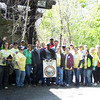 4.27.12 River Cleanup in Ilchester Area of Patapsco State Park With Nationwide Insurance Employees : Patapsco Heritage Greenway sponsored a watershed cleanup on a breezy Friday afternoon in April in the Ilchester Area of Patapsco State Parkland, near the Patapsco River in Ellicott City. Special thanks to our wonderful volunteers--Nationwide Insurance employees, HCC students as well as some of our other PHG friends--to help remove 2225 pounds from the Patapsco River watershed area! Most of this trash was a result of trash and junk washed down the river from a tropical storm back in September 2011, as well as litter washed down from nearby storm drains. PHG has been working with Patapsco State Park to clean up this area and what a difference these volunteers made in just a few hours! Aside from the usual bottles, cans, plastic bags and food wrappers we usually find in our cleanups (washed down storm drains from litter in the streets and parking lots); volunteers also removed: a lot of liquor and beer bottles, an inside car door handle, a rug, busted up safe, 7 car tires, McDonalds food wrappers, empty jewelry box, car keys, prescription bottle, a &quot;weird spring thing,&quot; a lot of broken glass, part of a cart, a lot of scrap metal pieces, 30 feet of webbing, an umpire or catcher chest protector, bedsprings from a mattress, a sheet, long plastic pipe, a STUFFED DUMMY (check out the photo on this one!!!!!), boy's shoes, men's shoes, a torn up and shredded shirt hidden in the dirt, bags of garlic mustard removed, part of a wood chair, part of a tire tread, old metal chain, used diaper, canvas bag, a &quot;disappearing hypodermic needle that was there one minute and gone the next...&quot; fire hose, hard drive to a computer, toilet lid, knife stuck in the side of a tree, unopened can of Budweiser Beer, satellite or power cable and railroad spikes. Some interesting nature spotting included: a whole rack of deer antlers, a northern bandit water snake, a live kitten that ran away, hundreds of tadpoles and mosquito larvae! A special thanks to our PHG Stream Captain Team members Betsy McMillion, Jeff Klein and Pete McCallum who led the group, and Christopher Hill from Nationwide Insurance who organized so many volunteers to come out and lend a helping hand! Great work and a big thanks to all of our volunteers for a job well done!