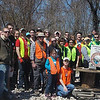4.6.13 Hammonds Ferry : The Patapsco Heritage Greenway lead a large group of volunteers from several organizations on April 16th to clean up 10,135 pounds of trash and other debris along a section of the Patapsco River on Hammonds Ferry Rd. Leading this group of 67 volunteers was our PHG stream captain team members Betsy McMillion, Jeff Klein, Pete McCallum, Darren Lloyd, Drew Henderson, Ted Willard and about ten other PHG members. We also couldnt have moved this amount of garbage without Cathy Hudson and her truck! The groups helping us were students from HCC, UMBC, Towson University &amp; the St. Joes School in Fullerton, USAF 32nd IS from Ft. Meade, Boy Scout Troop 1111 and a few individuals who just came out to help! Aside from the usual stream trash including bottles, cans, plastic bags &amp; food wrappers we always find in our cleanups, volunteers also removed:  59 tires, a pillow on a log, a fire hose, a full size mattress, wooden closet doors, a butterfly knife, a cooler, an inner tube, treated lumber &amp; a large amount of scrap wood, a lot of construction debris, asphalt &amp; cement, plumbing pipes, a wood pallet, window sills, bathroom tiles, a framed wall with a light switch, a recliner sofa &amp; chair, an armless cushioned chair, a white plastic Christmas tree, a car seat, a Chuck E Cheese balloon, a chicken coop, a tricycle, a very old Budweiser can, a toy medieval weapon, underwear, carpet padding, a car bumper &amp; other parts, a plastic tank, a bone-shaped dog bed, a section of sewer pipe, a dining table, 6 chairs &amp; side table, a Burger King Zesty Sauce, a shower stall soap dish along with an entire bathroom demo, ski pants, a large wooden cable spool, a plastic 12&quot; wheel, a piece of garden hose &amp; a Disney Princess Jeep. Some nature spotting included: Birds (Cardinal, Carolina Wren, Carolina Chickadee, Robin, Titmouse, Great Egret, Mallard, Canada Goose, Downy Woodpecker, Brown Creeper, American Crow &amp; Starling), a garden snake, deer bones (skull, cervical vertebrae &amp; some ribs), a decomposing deer leg &amp; probable dog bones (different sizes of scapulas &amp; femurs, a piece of a pelvis, 2 upper left mandibles with teeth--one small and one large). We also put our volunteer engineers to work to create a berm to discourage future dumping down the access road along the river.