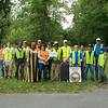 5.20.12 River Cleanup with Northrop Grumman Employees in Patapsco State Park Avalon Area : Patapsco Heritage Greenway sponsored a watershed cleanup on a Sunday afternoon in May in the Avalon Area of Patapsco State Park, along a section of the Patapsco River from Gun Road to the Thomas Viaduct Bridge. Special thanks to our wonderful partners--Northrop Grumman employees and other PHG friends--to help remove 795 pounds of trash and debris from the Patapsco River watershed area! Most of this trash was a result of litter and debris washed down the river from a tropical storm back in September 2011. PHG has been working with Patapsco State Park to clean up this area, and what a difference these volunteers made in just a few hours! Aside from the usual bottles, cans, plastic bags and food wrappers we usually find in our cleanups (washed down storm drains from litter in the streets and parking lots); volunteers also removed: a ceramic bowl, plenty of broken glass, a boogie board, a mud flap, a highway cone, a suitcase, a pair of broken glasses, used lumber with protruding nails, newspapers, a used condom, 7 ft. of electrical conduit plastic pipe, carpet, a pile of rusted nails, an old shoe, black fencing, a rusted grate, a wooden stake, a workman's bag, a busted inner tube, ground wire, metal screen, auto fluid bottle, a brand new tire with a chrome plated rim, a car seat, a pair of blue jeans, a plastic planter, sand bags, a swimming noodle & blue raft, a yellow bucket, surgical gloves, hair spray can, a dog brush, Dunkin Donuts cup, used baby diaper, a bicycle petal and a white soup bone. Some interesting nature spotting included: many butterflies, a neon green colored bug, a black snake, a deer skull and a grave marker for 15-year old Sid the dog! A special thanks to our PHG Stream Captain Team members Betsy McMillion, Jeff Klein and Pete McCallum who led the group. Finally, we are so grateful to Robin Sokoloski from Northrop Grumman, who recruited so many incredible volunteers who helped make this clean up a huge success!!!