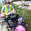 5.6.12 New Cut Road Trash &amp; Invasive Plant Removal by HCC Student Molly Freiert : As part of a HCC Student Service Learning project, college student Molly Freiert partnered with our PHG Stream Watcher Carol Curley to complete a stream cleanup in Ellicott City. Carols Stream Watch Project has been to clean up the entire stream that runs parallel to New Cut Road; and she has coordinated cleanups along this stream with several groups over the past 2 years, with only one region left untouched. Molly targeted the one remaining area that needed cleaning up, removing the trash and began removing the invasive garlic mustard growing along the stream banks as well. For 12 hours, Molly collected over 10 bags of trash/garlic mustard--removing about 100 pounds from this area of the Patapsco River watershed! Great work, Molly and Carol!!!!
