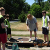 July 2010 Storm Drain Stenciling Project in Catonsville Community : Boy Scout Bruce Donoghue, from Troop 1022 earned his Eagle Scout Award from a project partnering with the Friends of Patapsco Valley &amp; Heritage Greenway, with a storm drain stenciling and watershed education project in the summer of 2010.  Targeting the Rollingwood neighborhood in Catonsville, Bruce led a group of scouts to distribute information to local neighbors about how to stop water pollution in their own backyard and a letter explaining that storm drain stenciling &quot;disks&quot; would be placed on storm drains in the near future!   Later, the scouts placed these storm drain stencil disks (Baltimore County prefers to use disks rather than painting storm drain stencils...) on storm drains throughout the neighborhood.  Special thanks and congratulations to Bruce Donoghue on earning his Eagle Scout project and helping us educate citizens about water pollution issues in the Patapsco River watershed!